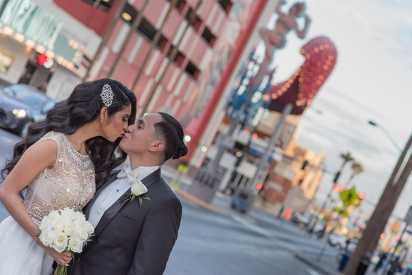 downtown vegas wedding photo tour of couple with yellow bouquet