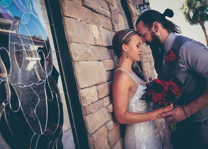 Las Vegas wedding chapels - Couple with their foreheads touching and eyes closed feeling the sentiment of newlywed love