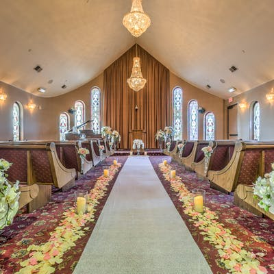 Rose Petal lined aisle in the chapel