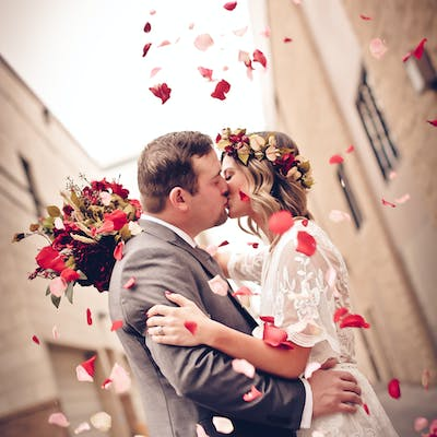 Signature Photo Session - Couple kiss while rose petals fly