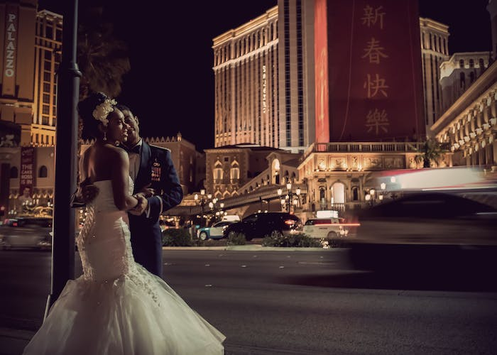 Beautiful wedding couple with the Venetian Hotel in Vegas in the background