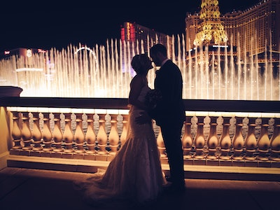 A wedding couple silhouetted in front of the waterfalls at the Bellagio - Captivate Package