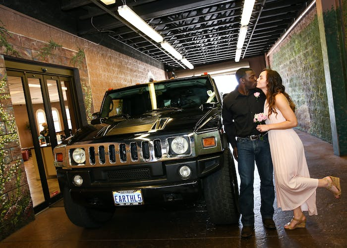 Newlyweds and their hummer in the drive thru chapel