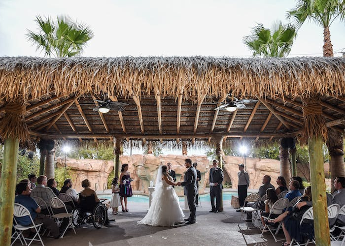A big outdoor afternoon poolside wedding under the gazebo