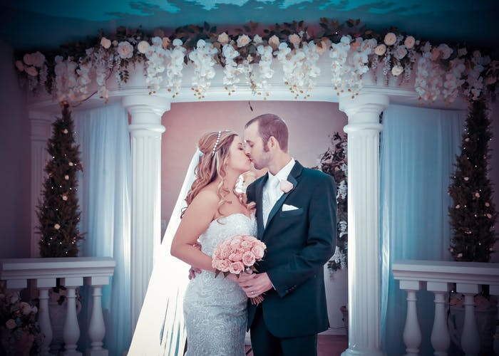 Beautiful newlyweds kiss in The Wedding Garden
