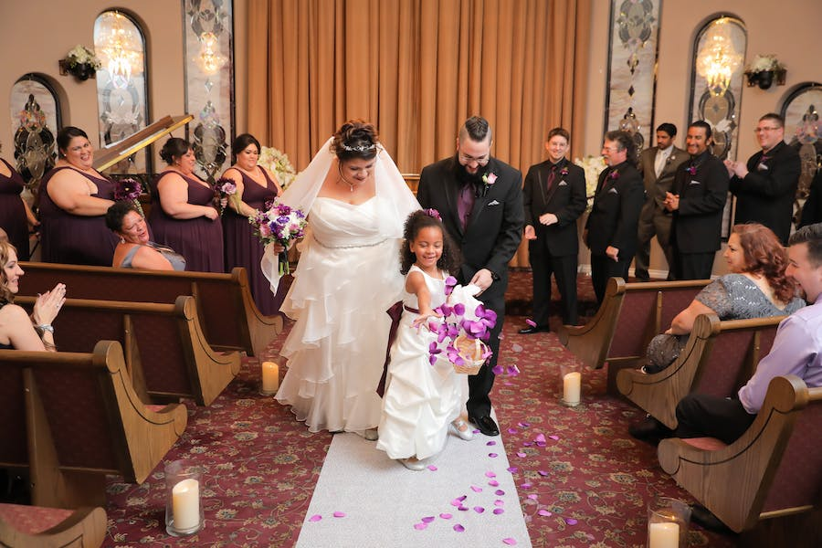 Flower Girl Scattering Petals Down The Aisle