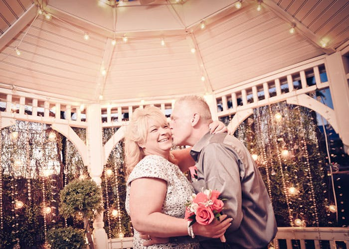A married couple in the gazebo