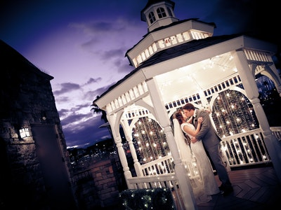Couple kisses outdoors in The Terrace Gazebo