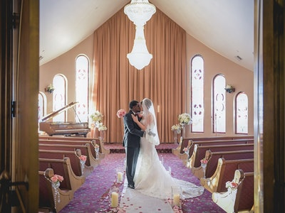 Newlyweds embrace in a beautiful sunlit chapel - Chapel Packages Graphic
