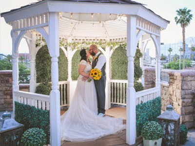Vegas outdoor wedding Newlyweds kiss in the Gazebo